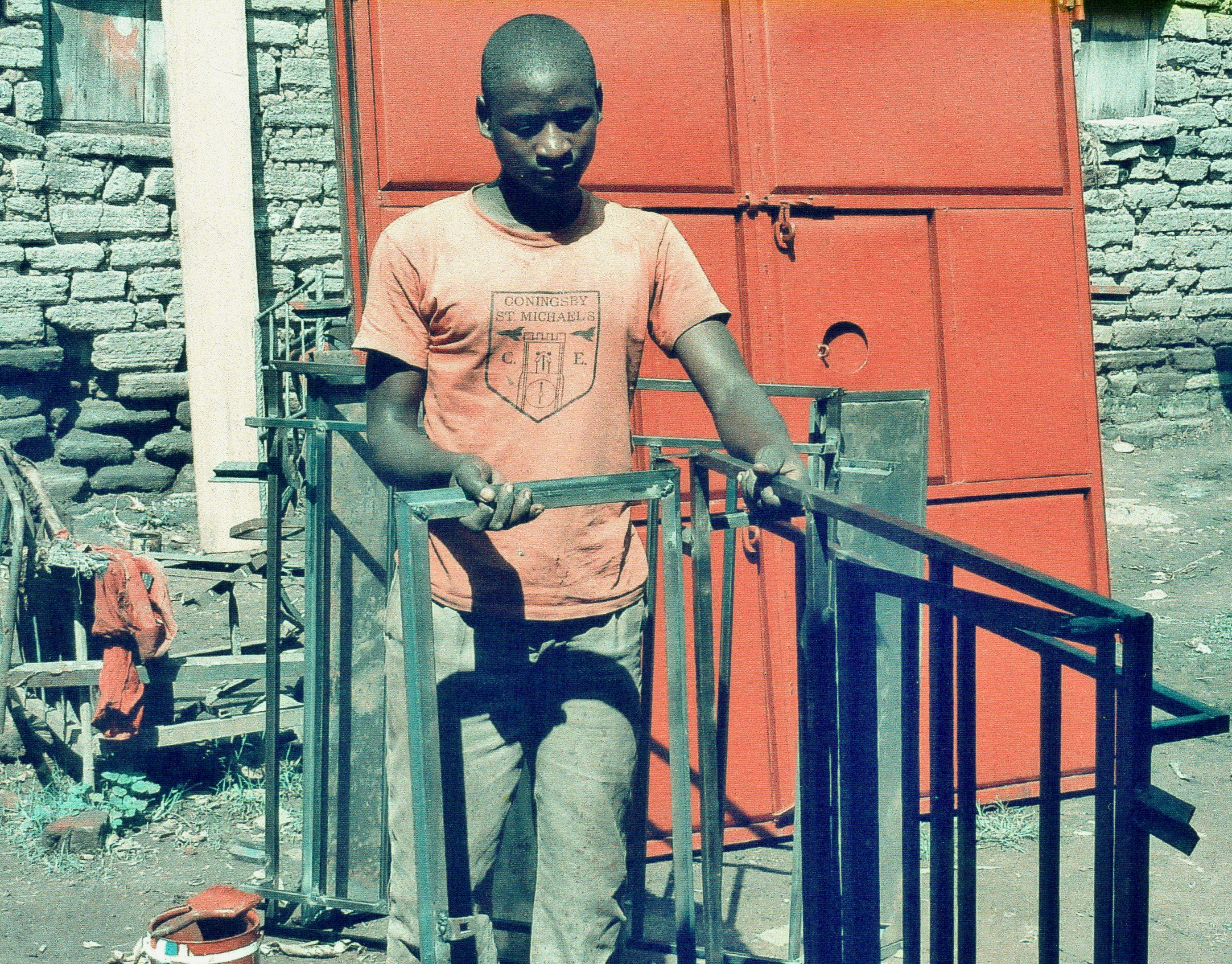 Silent Voices 3 supports Deaf young people. John Bosco has learnt to weld  metal window frames.